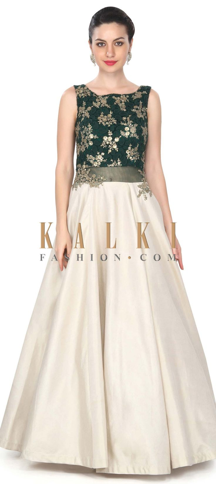 Buy this  Light gold gown with green paisley motif embroidery only on Kalki