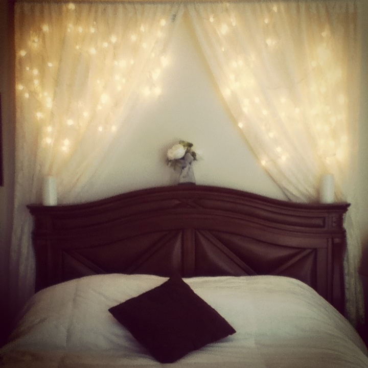 A very cheap way to spice up your bedroom. 1curtain rod, left over Christmas lights, and some lace curtains.  Very romantic.