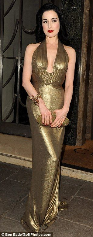Dita Von Teese sticks to floor-length and plunging necklines as she goes from goddess green to gold | Mail Online