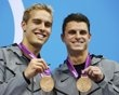 Kristian Ipsen and Troy Dumais of the U.S. smile with their bronze medals during the men's synchronised 3m springboard victory ceremony at the London 2012 Olympic Games at the Aquatics Centre