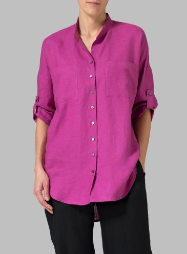 Relaxed blouse fabricated from lightweight linen lends a relaxed silhouette and a comfortable wear.
