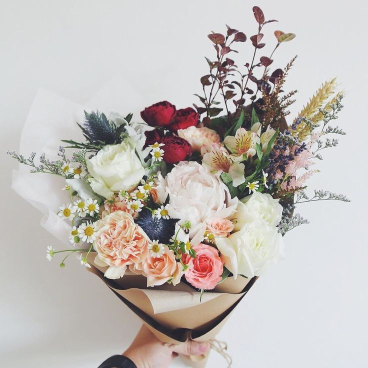 We've got some dried Wheat Lavenders Astilbe Daisies Roses Garden Rose sprays Apple Tea Carnations Eryngiums and Alstromerias together with a Peony nestled in the middle. Mmmm.. Mondays. #windflowerflorist #sgflorist #peony http://ift.tt/1GBLKkb by windflowerflorist