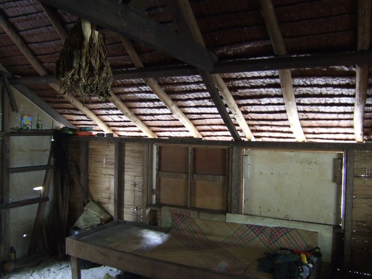 Inside a Papua New Guinea vernacular house, bamboo walls and sago leaf roof, earth floor