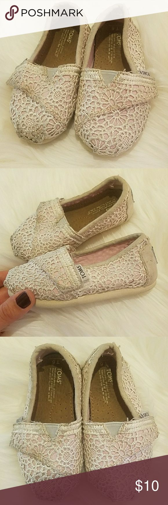 Pink/white floral Toms Pink and white/off white Floral Toms. Size T6 (toddler) good, used condition. Could use a light cleaning on outside because of the light colors. Insides are great condition. Toms Shoes Sneakers