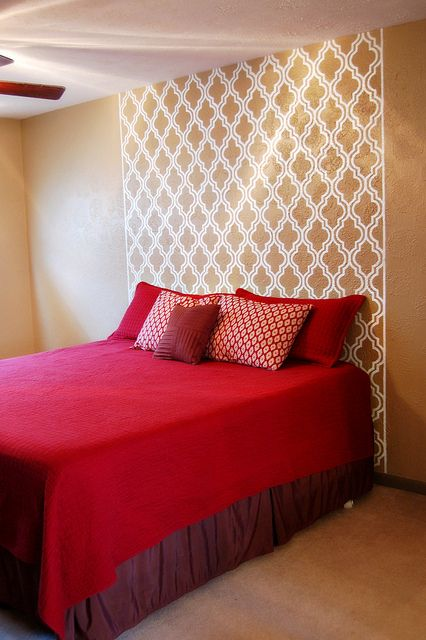 diy stencil painted headboard on the wall