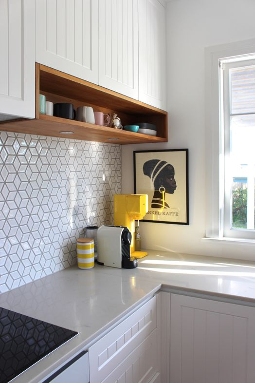 Panelled cabinetry and cube tiles