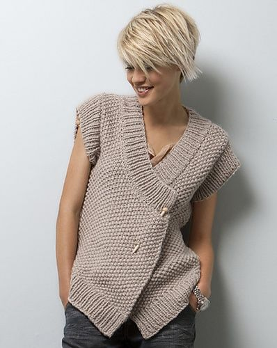 I have a sweater similar to this that is missing some buttons.  This is a neat way to secure and wear that sweater! Yay!! :)