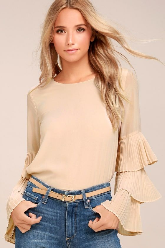 You won't soon be forgotten when you don the One For the Ages Beige Long Sleeve Top! Woven poly falls from a rounded neckline, into a wide-cut bodice with long sleeves that boast tiers of fluttering pleats. Back keyhole with top button.