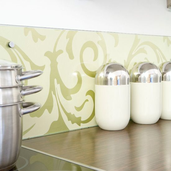 Custom back splash - wallpaper behind clear glass. Easy to update as often as you want. Smooth, easy to clean surface, very important in the kitchen.
