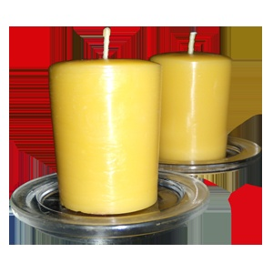 Beeswax votives with old glass canning jar lids as saucers