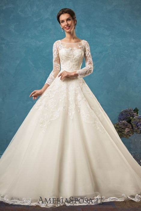 Wedding dress Alessia - AmeliaSposa.   Dignity and grace that differ a classic silhouette from others are added with a trendy accent – massive lace that fully demonstrates its beauty on the back and long sleeves. Openwork patterns flow down the skirt and train claiming to be the main adornment.