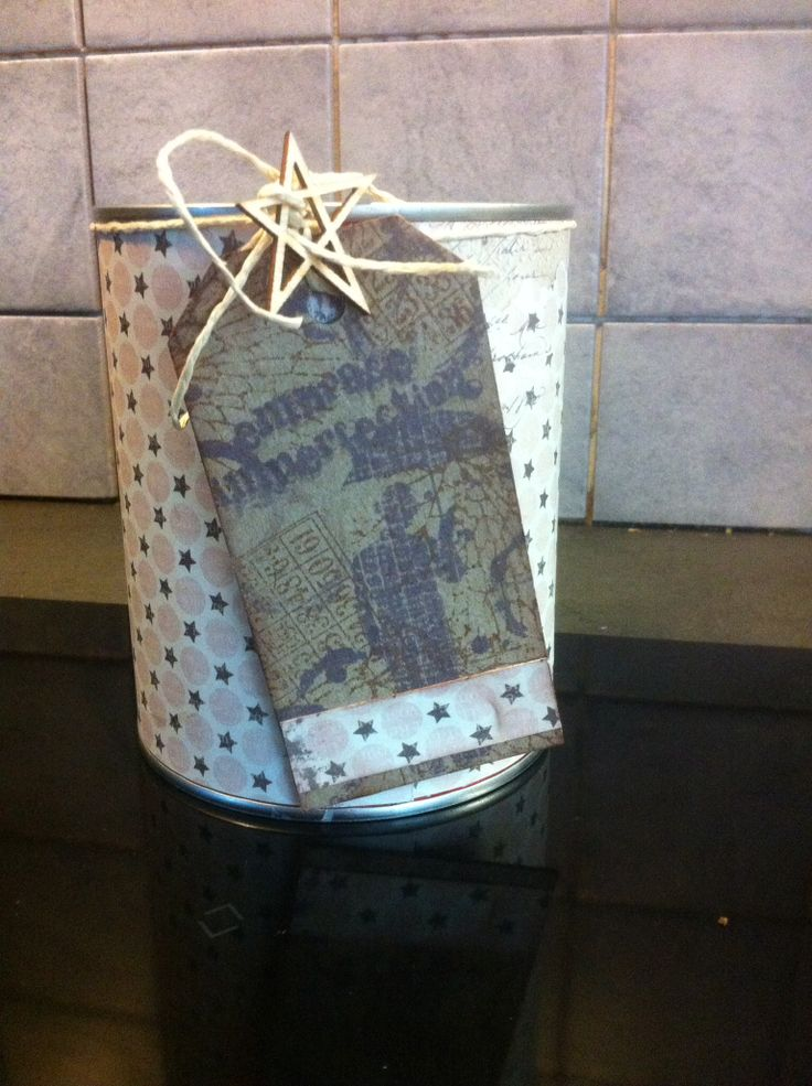 Papers from Bo Bunny and stamps from Tim Holtz. This can is going to be great for tea-bags :)