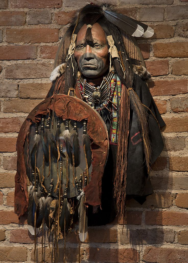 """Loud Bear, Calendrical History was recorded by pictographic images painted on buffalo hides which recorded the prominent occurrence of the year. In 1855 the name """"they-tore-off-the-Crow's-headdress-wi"""