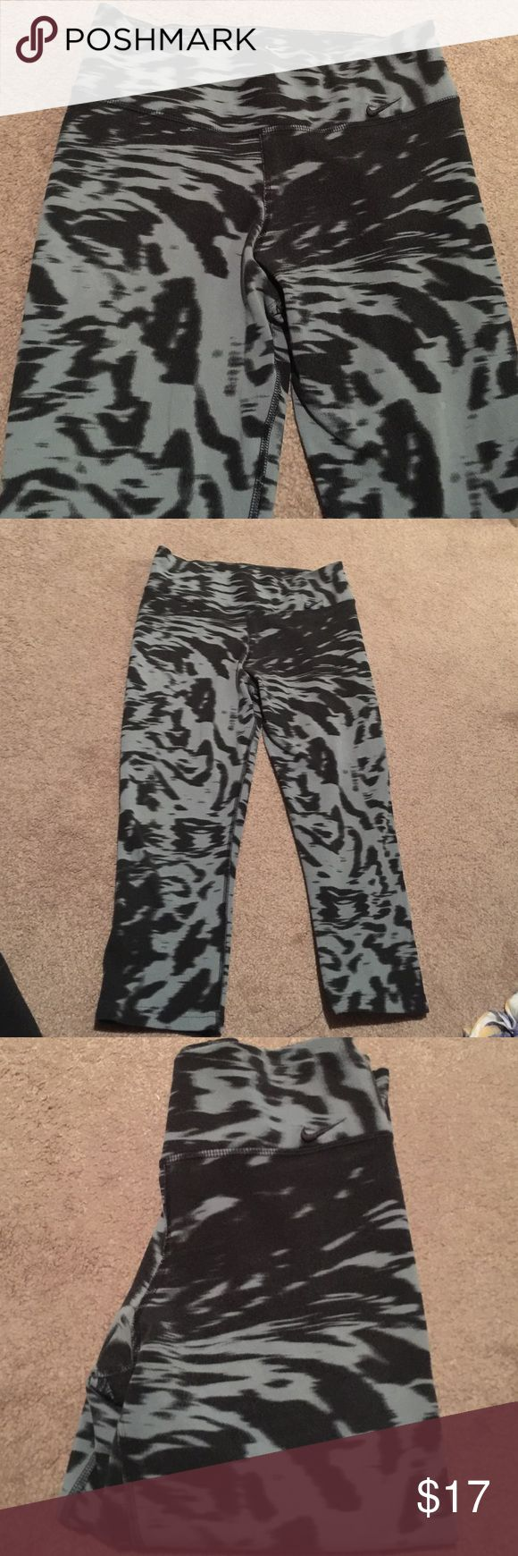 Nike leopard dry fit Capri . Size small Nike dry Fit workout Capri.  No stains. Grey and black. Very comfortable ! Nike Pants Track Pants & Joggers
