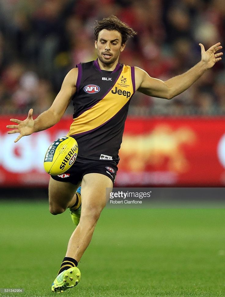 Sam Lloyd of the Tigers kicks the ball during the round eight AFL match between the Richmond Tigers and the Sydney Swans at Melbourne Cricket Ground on May 14, 2016 in Melbourne, Australia.