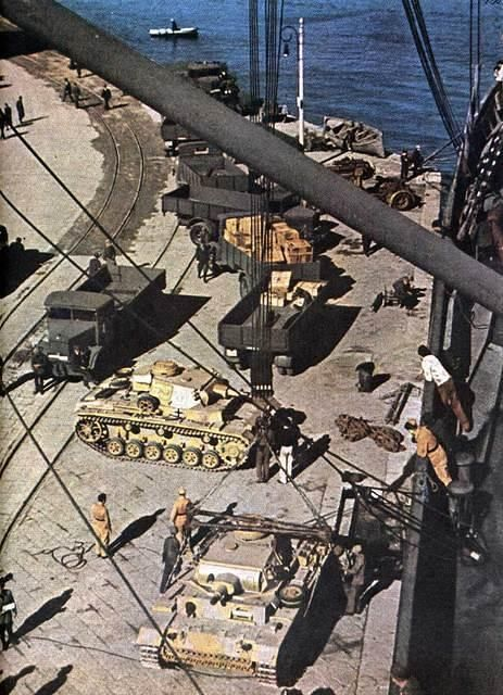 Afrika Korps - Panzer III are unloaded from the ship in Africa