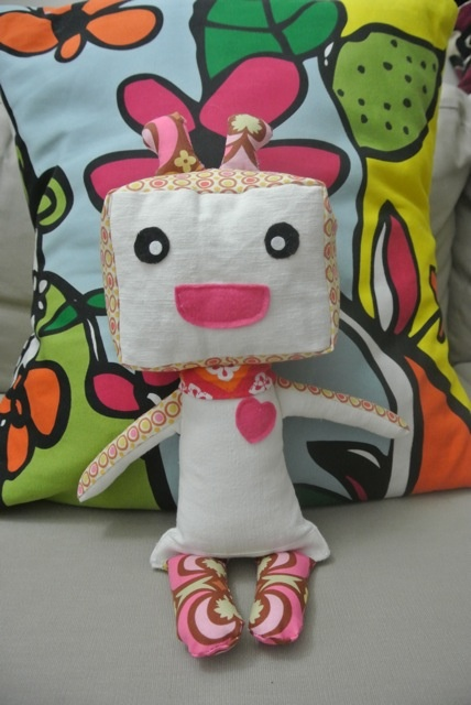 """Pinkie PikuBot"" - approx 10"" tall. Made with soft cotton fabrics and felt accents. Collar has a small bead accent. (You can specify if you wish to have the PikuBot made for under-3 yrs, and any small bead elements will be removed.)"
