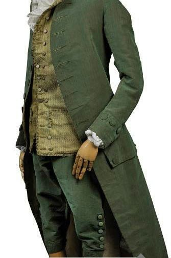 """A gentleman's suit of """"changeable"""" velvet, France, third quarter of the 18th Century. Reversing to pink, the breeches fall fronted, with velvet buttons and associated waistcoat of green figured silk trimmed with green silk fringed braid."""