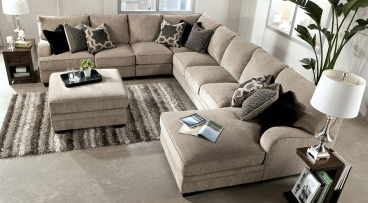 The new best selling Katisha Sectional Collection by Ashley Furniture establishes a warm, inviting atmosphere by pairing maximum comfort with stylistic charm. Perfect for watching your favorite movie with your family or cheering on your favorite sports team, relax in the supportive comfort of the Katisha Platinum Sectional Collection from FurniturePick. Featuring different pieces, and