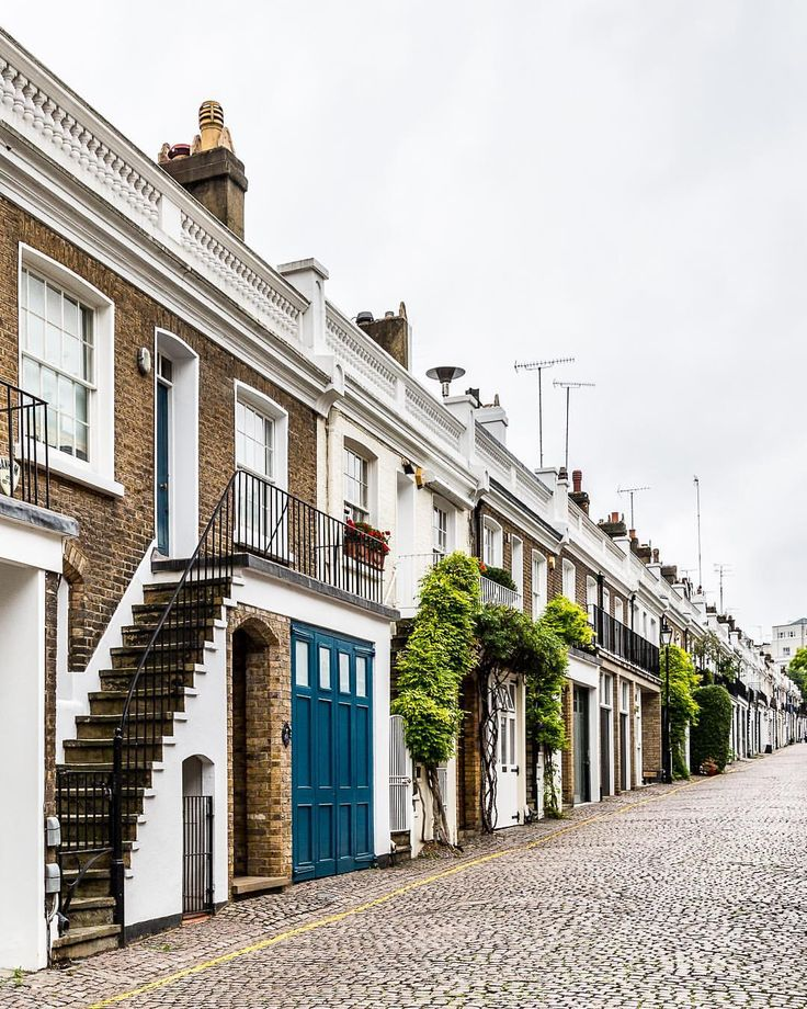 Pretty houses in Holland Park Mews, London