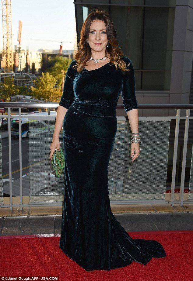 Elegant: Til Death's Joely Fisher, 48, made a statement in a deep turquoise…
