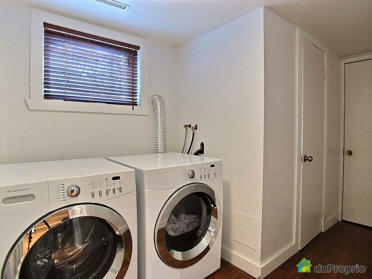 All this laundry room needs is a counter across the machines and a cute little IKEA cabinet to store detergent.