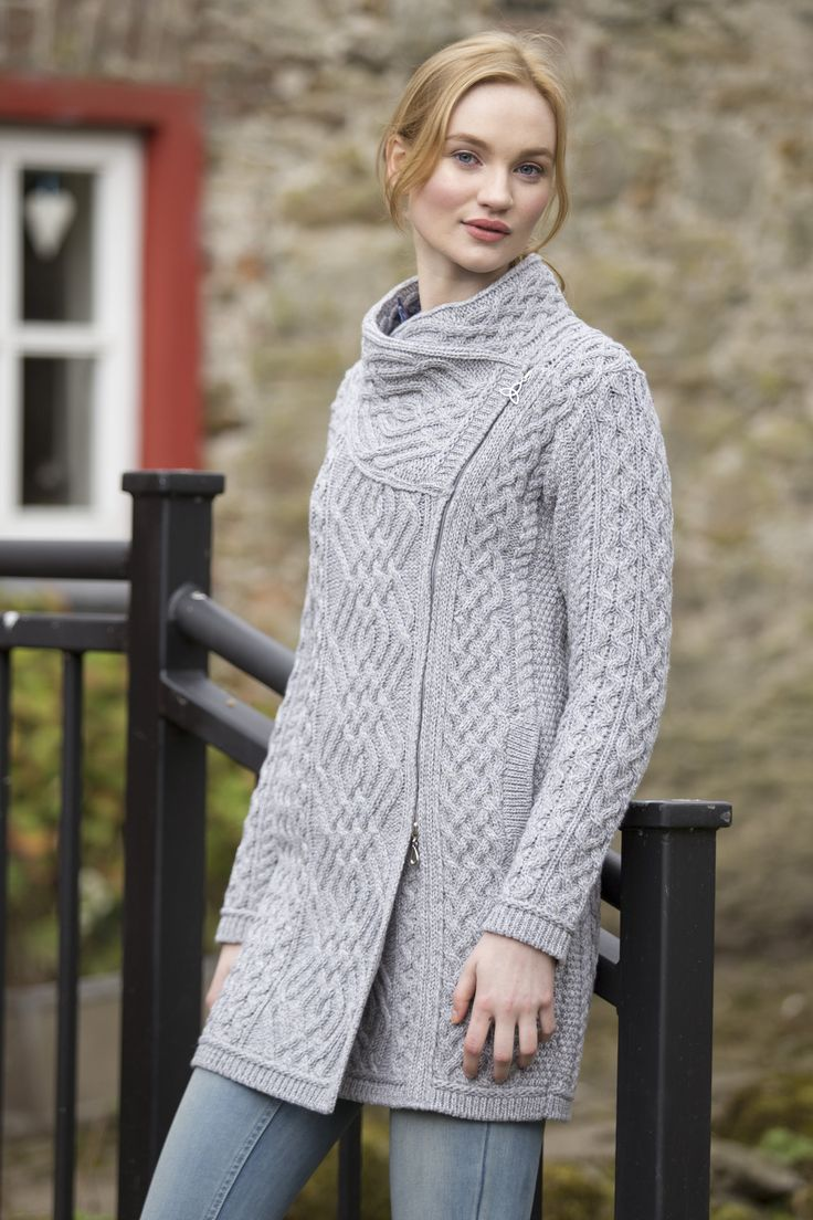 Made from 100% Merino Wool This beautiful cable knit double breasted coat is very on trend for the season. It features the diamond trellis stitch along the centre of the coat and the side zip along th