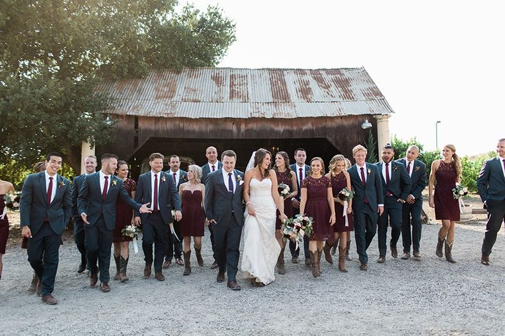 San luis obispo rustic wedding at dana powers house and barn bride strapless mermaid style lace gown with sweetheart neckline and small crystal belt with medium length veil with groom slate blue notch lapel suit with white dress shirt and long navy blue tie with white pocket square and floral boutonniere with bridesmaids short lace burgundy dresses with groomsmen slate blue suits with long burgundy ties