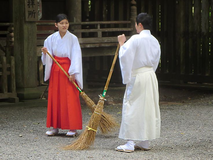Shinto priests pause for a chat at the Amanoiwato Shrine in Takachiho on Kyushu Island, Japan.