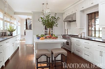 Beautifully Updated Tudor-Style Home | Traditional Home…love the stools