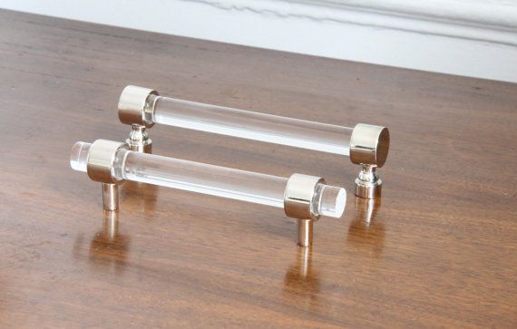 Custom lucite cabinet pulls. Perfect for cabinets and drawers. Pulls consist of 2 polished nickel cabinet mounts and polished 1/2 lucite rod. Mounting