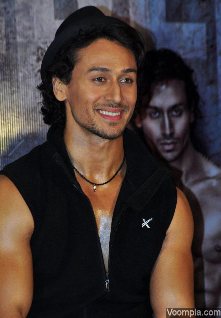 Tiger Shroff photographed in his signature look - a hat and a sleeveless jacket! via Voompla.com