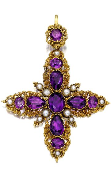 An antique amethyst, seed pearl and gold cross pendant.