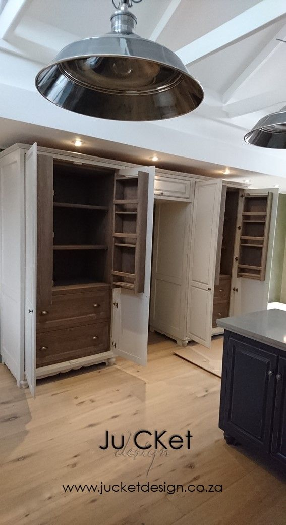 RESIDENTIAL - Project and Photography by Ju'CKet DESIGN. Double Door pantry for storage of dry and tinned food items either side of Fridge-Freezer.   French oak timber flooring add to the delight of the kitchen interior.