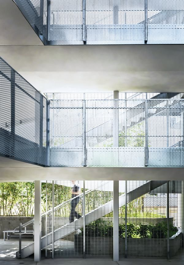 Much of the circulation in the building is accommodated by open-air pathways, with railings of perforated aluminum that nod to the buildings skin.