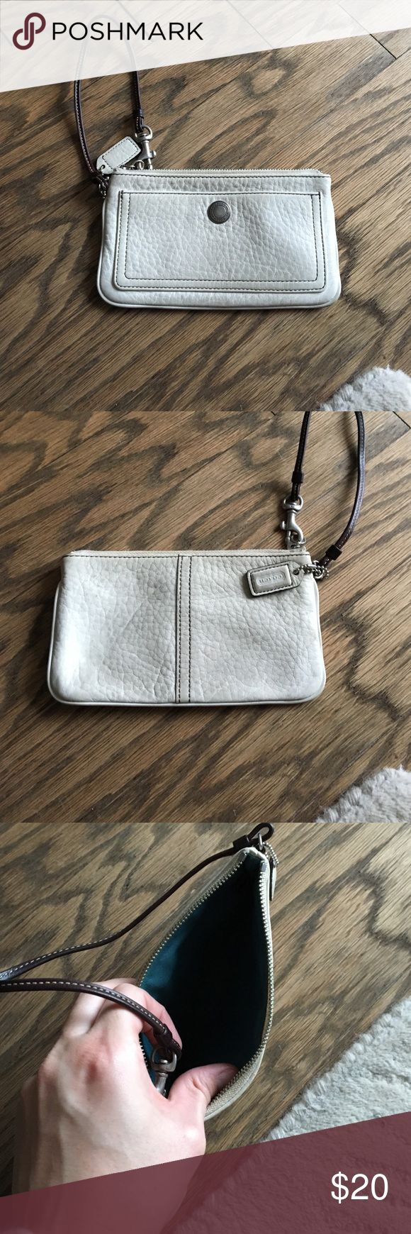 Coach leather wristlet Ivory pebble leather. Business Envelope length size. Exterior pouch. Leather looks worn and slightly discolored Coach Accessories