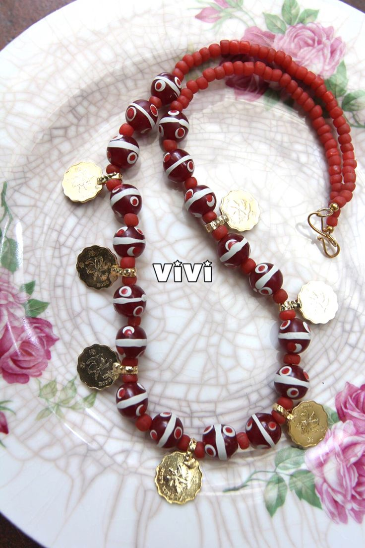 Replica of vintage coins mix with glass beads.