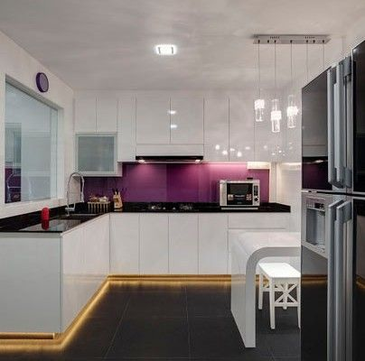Purple glass backsplash and a window cut-out in this kitchen