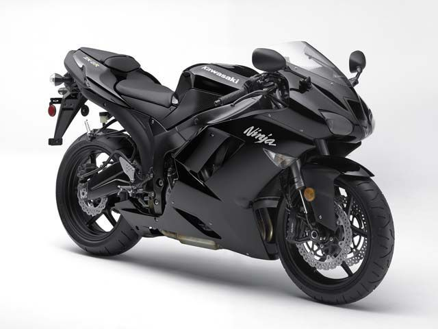 Kawasaki Ninja. I am GOING to own this one day. Maybe I'll get this instead of buying another car when mine finally bites the dust.
