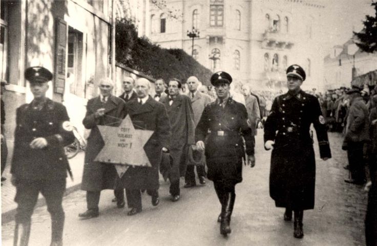 Jewish prisoners paraded by the SS and local police through the streets of Baden-Baden, November 10, 1938.   Yad Vashem Photo Archives 138FO8