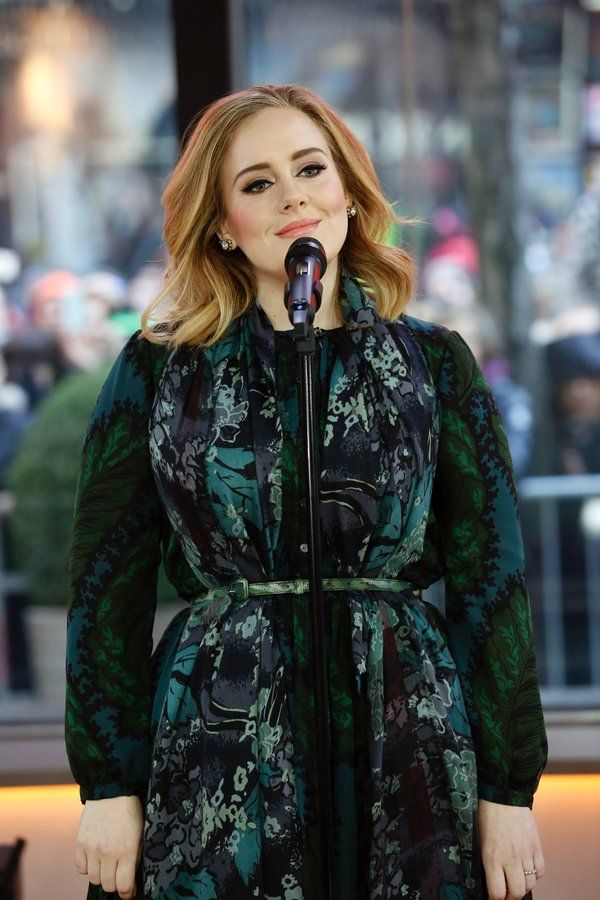 Adele is all class in this belted wrap! Not afraid to wear clashing prints and showing off an hour glass figure by drawing attention to her waist. Stunning!