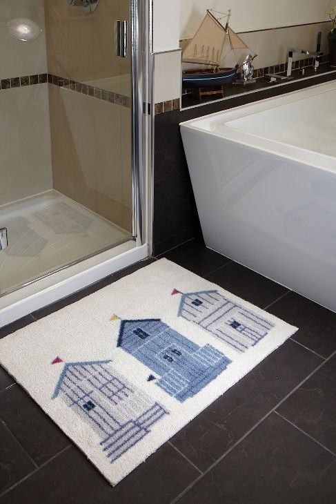 Hug Rug Bath Mat Bath 13 Beach Huts. A highly absorbent cotton rich pile and a white, waffle style backing to give excellent grip on a hard bathroom floor. Machine washable at 30*C year after year.