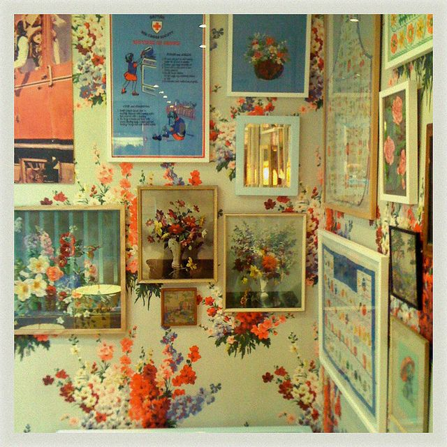 chintz and vintage art, I would find it difficult to cover up that wall paper!
