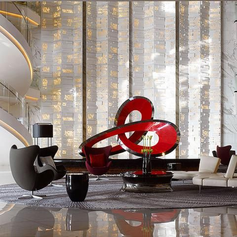 A dramatic three-meter red steel sculpture by Australian artist Matthew Harding sits in the atrium of the Four Seasons Hotel Guangzhou, designed by HBA/Hirsch Bedner Associates.