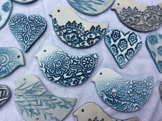 Anjie's air dry clay birds, impressed with lace, old wooden printing blocks and leaves. Pottery, ceramics, brooches, blue and white pottery:
