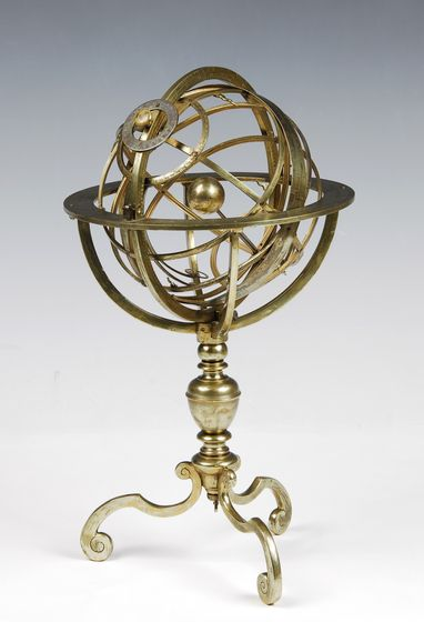 Armillary sphere by Carlo Plato, Rome, 1588.  The armillary sphere was an emblematic instrument of Renaissance astronomy. It contained the principal circles astronomers used when studying the motions of the heavens – the equator, tropics and ecliptic (the annual path of the sun) – and it could turn on an axis pointing to the pole and adjustable for latitude. The earth is at the centre and the curly points are stars on the celestial sphere.