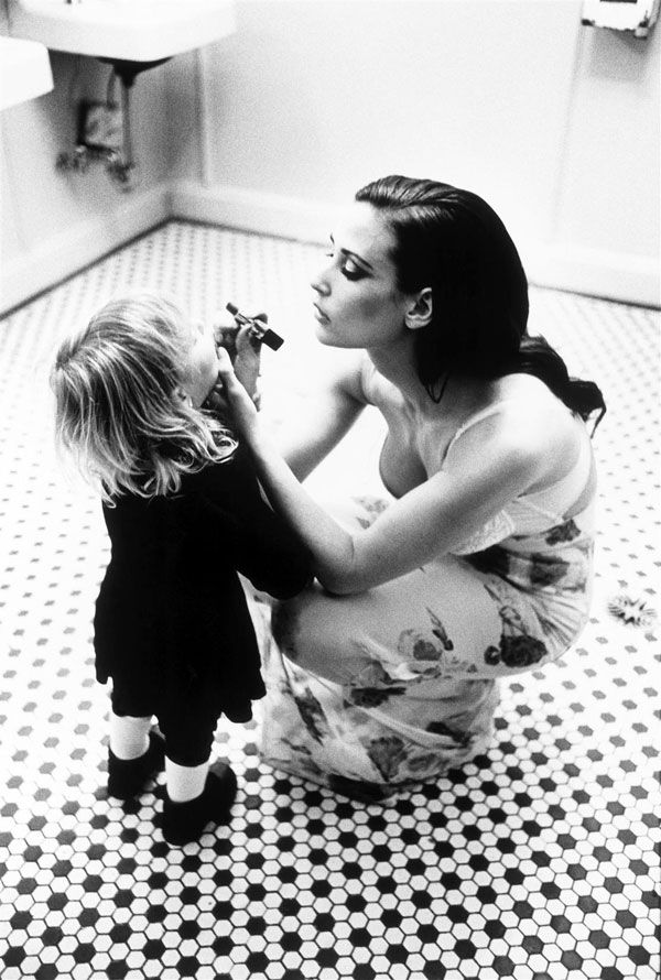 Reminds me of how mom would let me sit on the counter when she got ready. I'd want to do everything she did. Miss her. by Ellen Von Unwerth