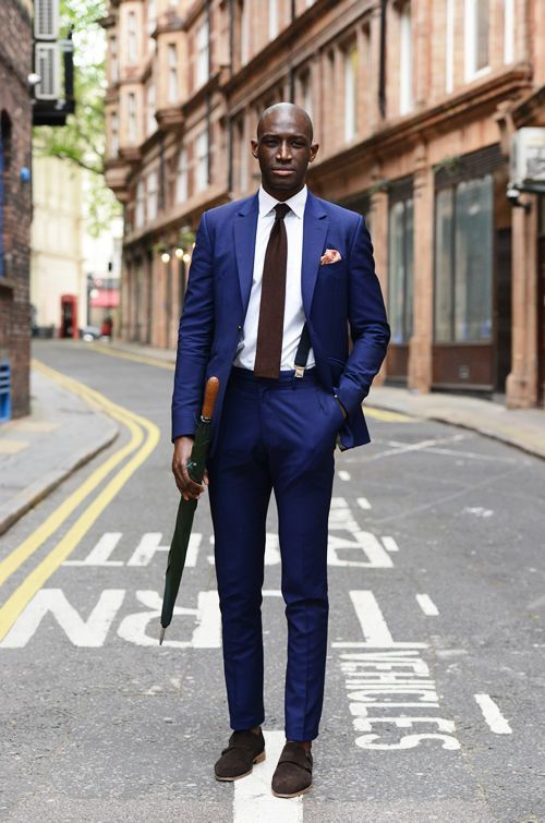 Dress in a Drak Blue Sinle Breasted with a White Shirt and a pair of Monk Strape…