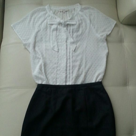 Ann Taylor Loft white  pussy bow top This white button up from Ann Taylor Loft features a sweet little tie at the neckline is gathered softly around the neck loose fitting shirt with a shirttail hem LOFT Tops Blouses