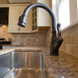 Oil Rubbed Bronze faucet with undermount stainless sink . . . these look good together!